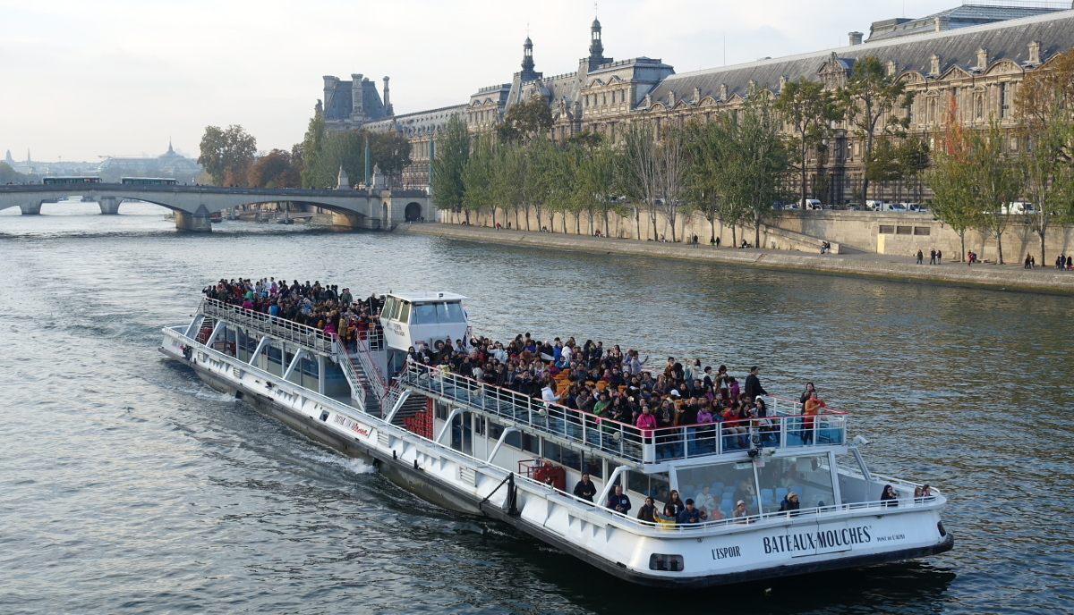 Sightseeing boat Seine Paris by Guilhem Vellut from Paris France